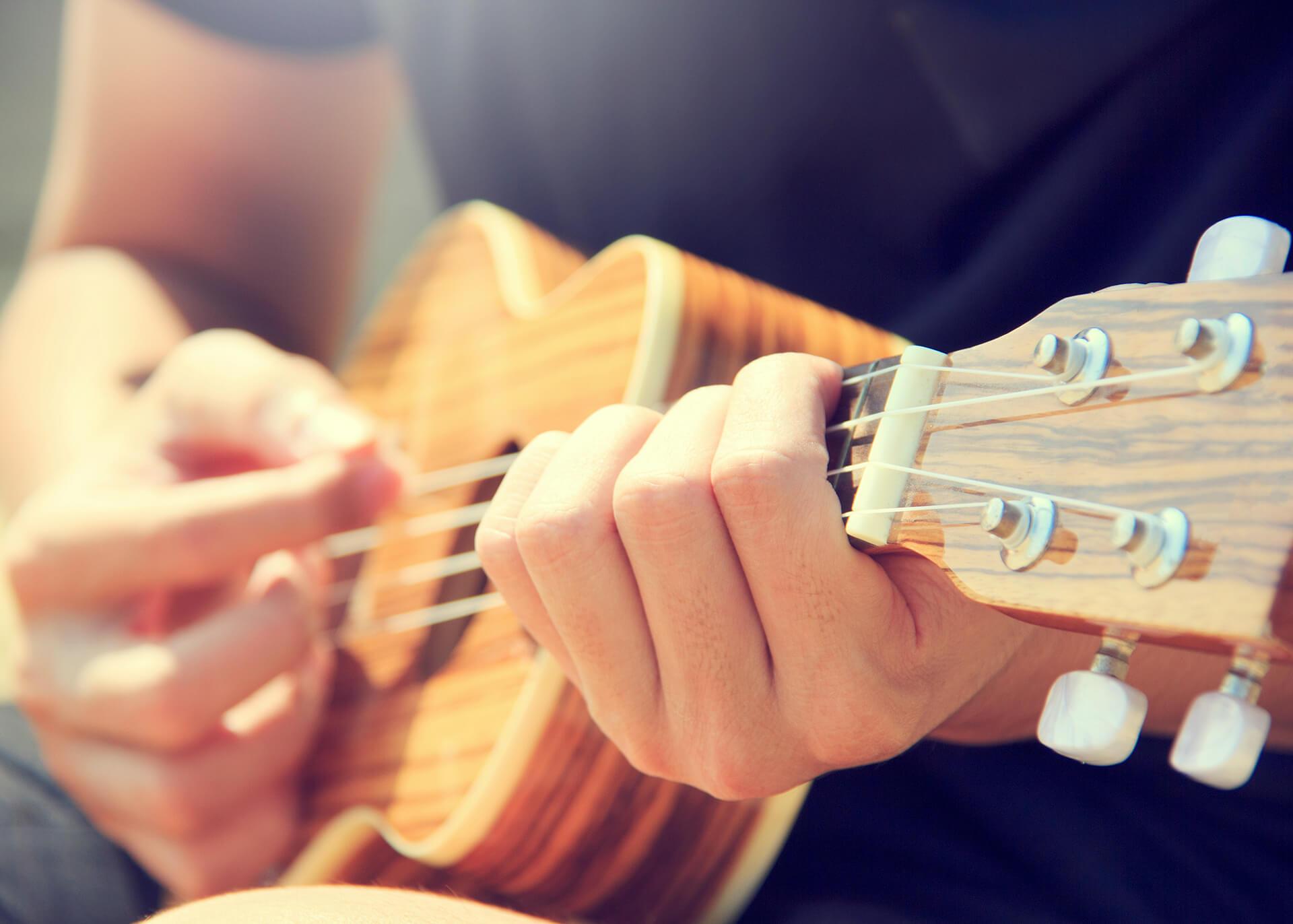 guy playing ukulele