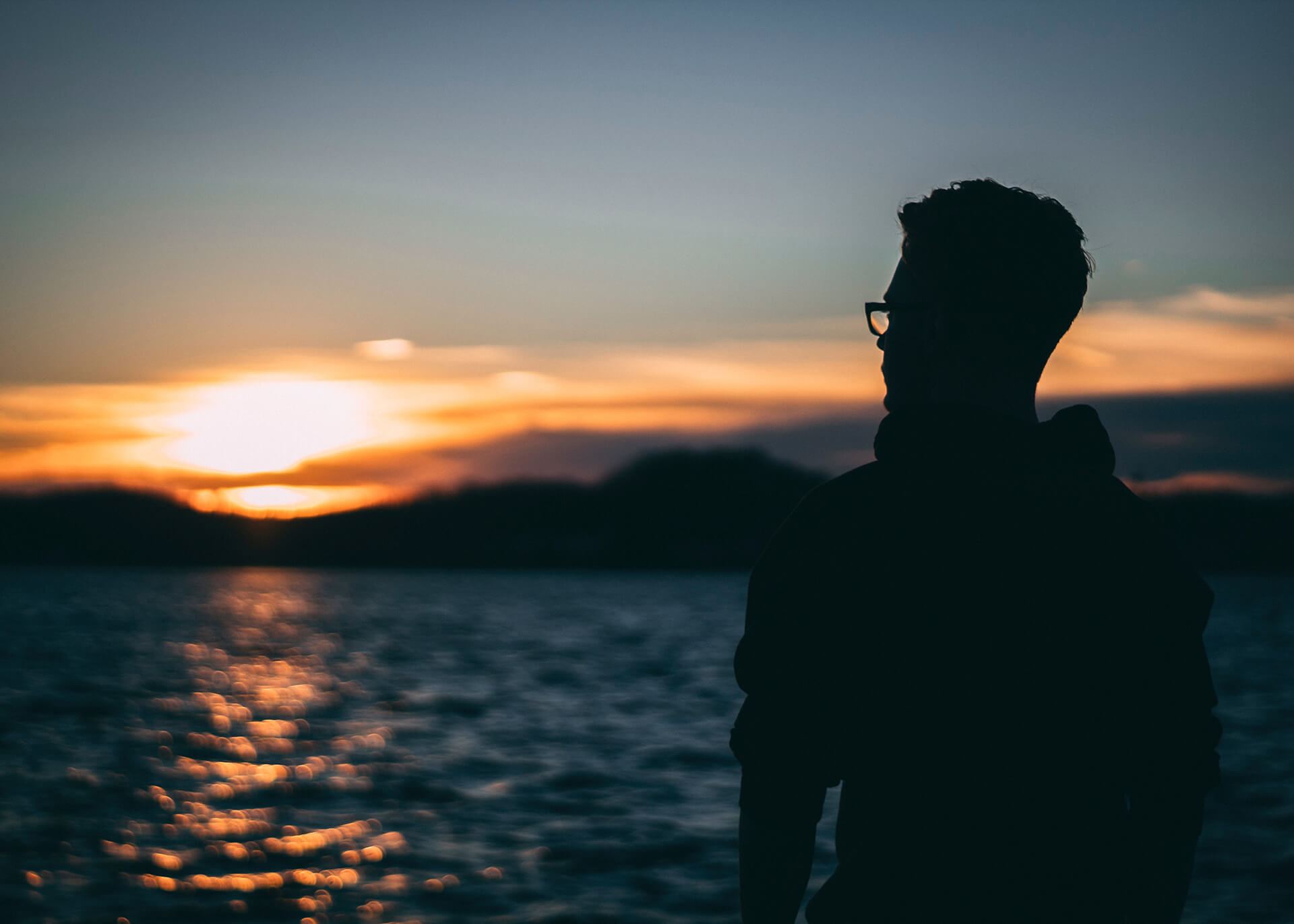 guy watching the sunrise