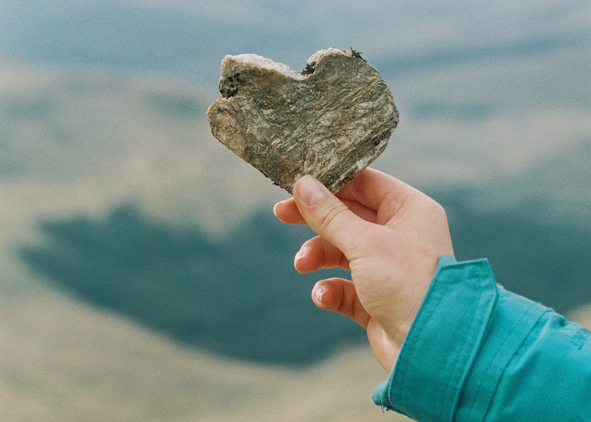 woman holding love heart made of stone