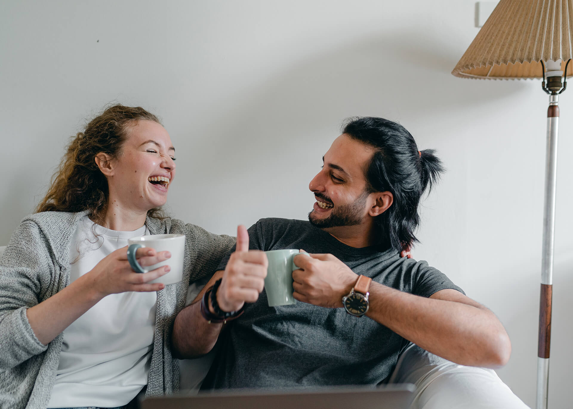 couple drinking tea and laughing