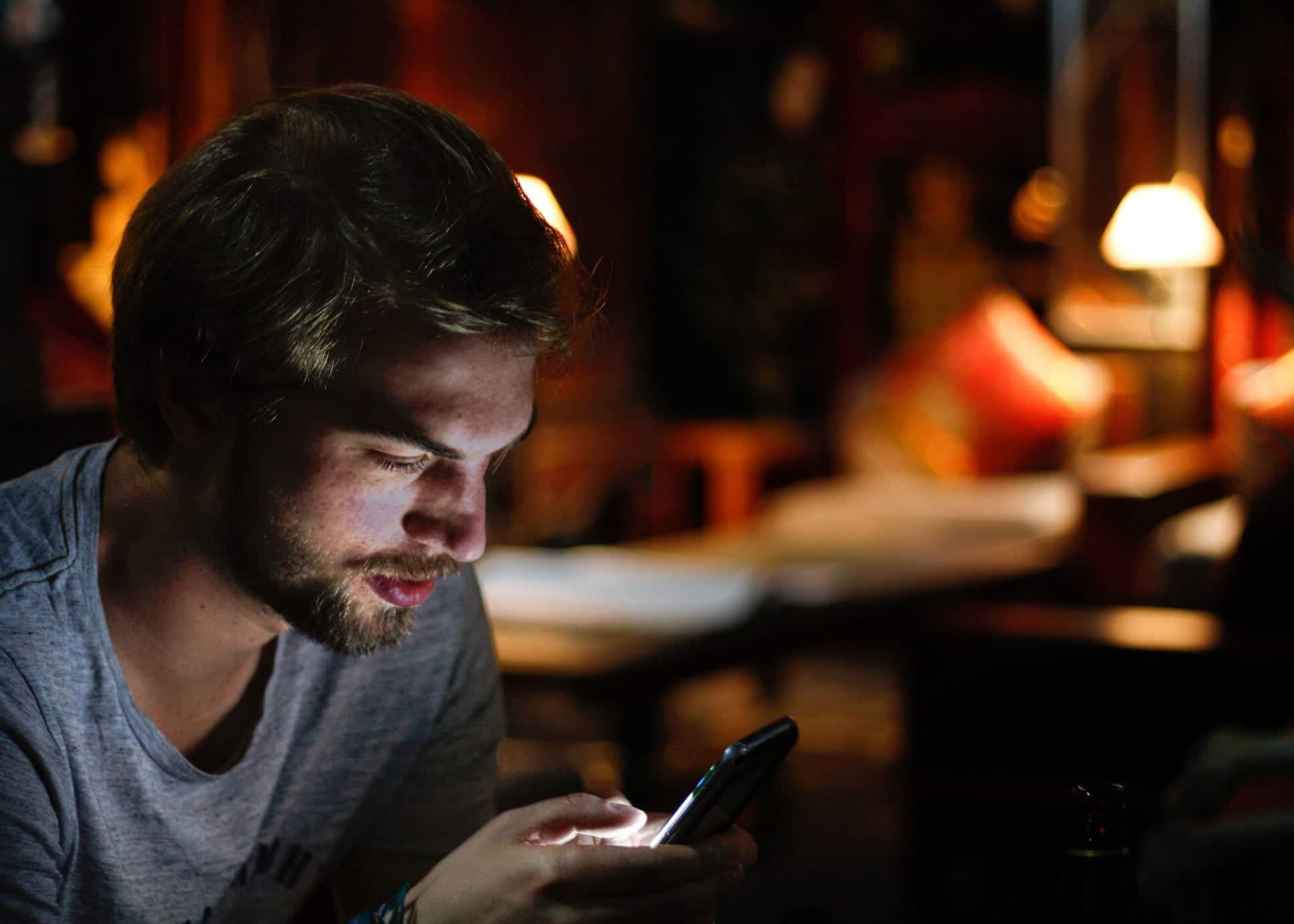 guy texting at night