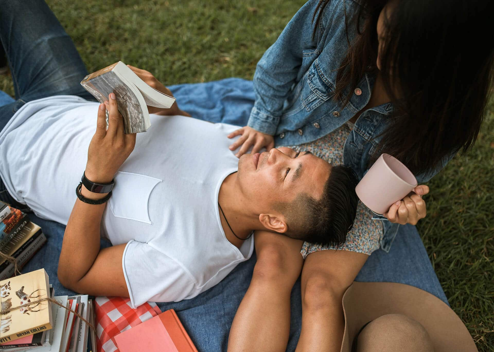 guy laying on girls lap