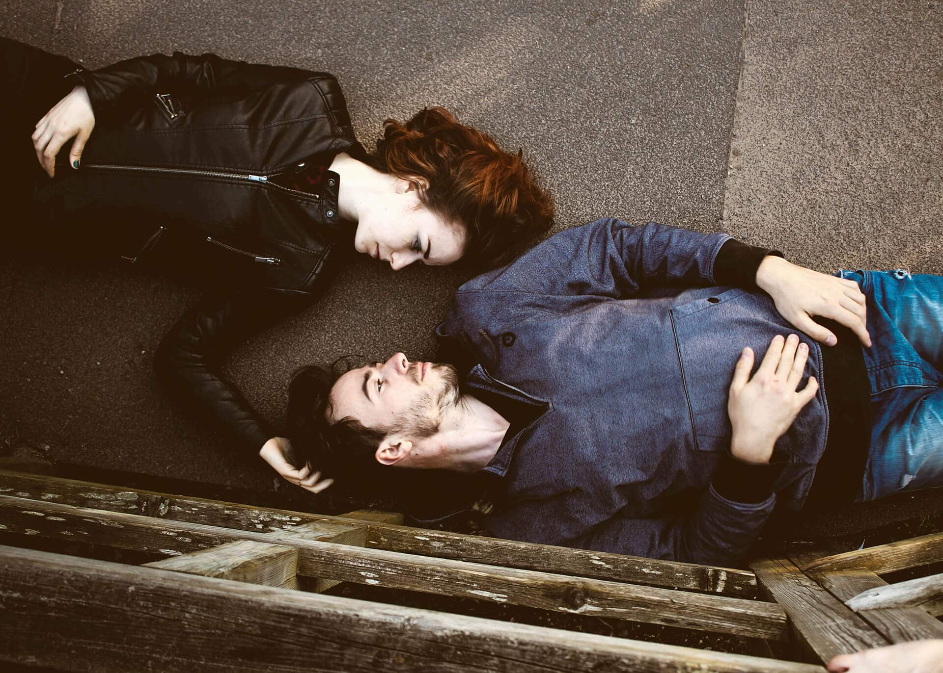 woman and man laying on the ground