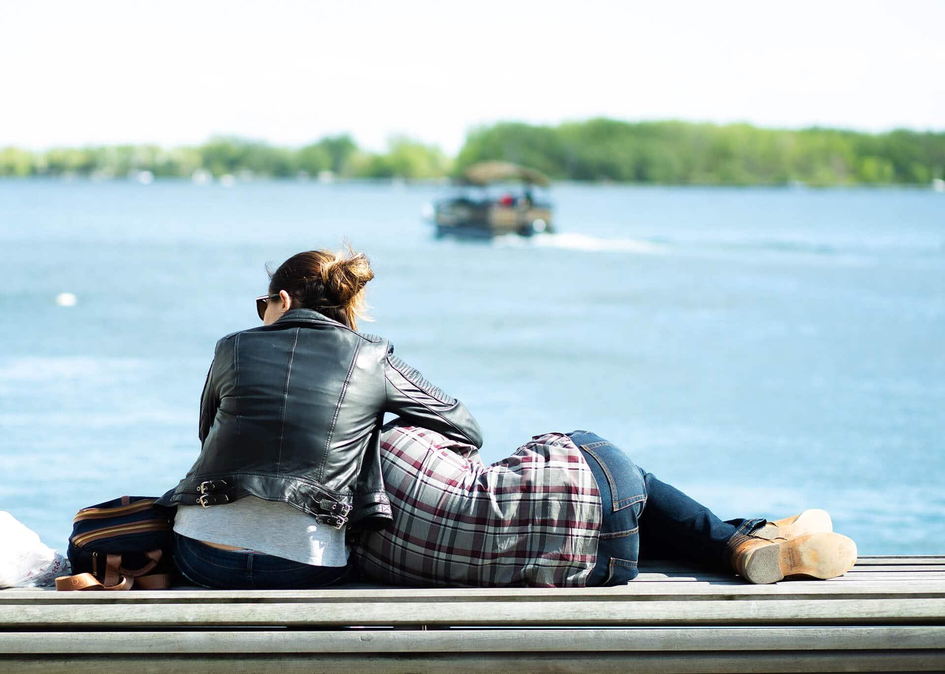 couple sitting at the lake