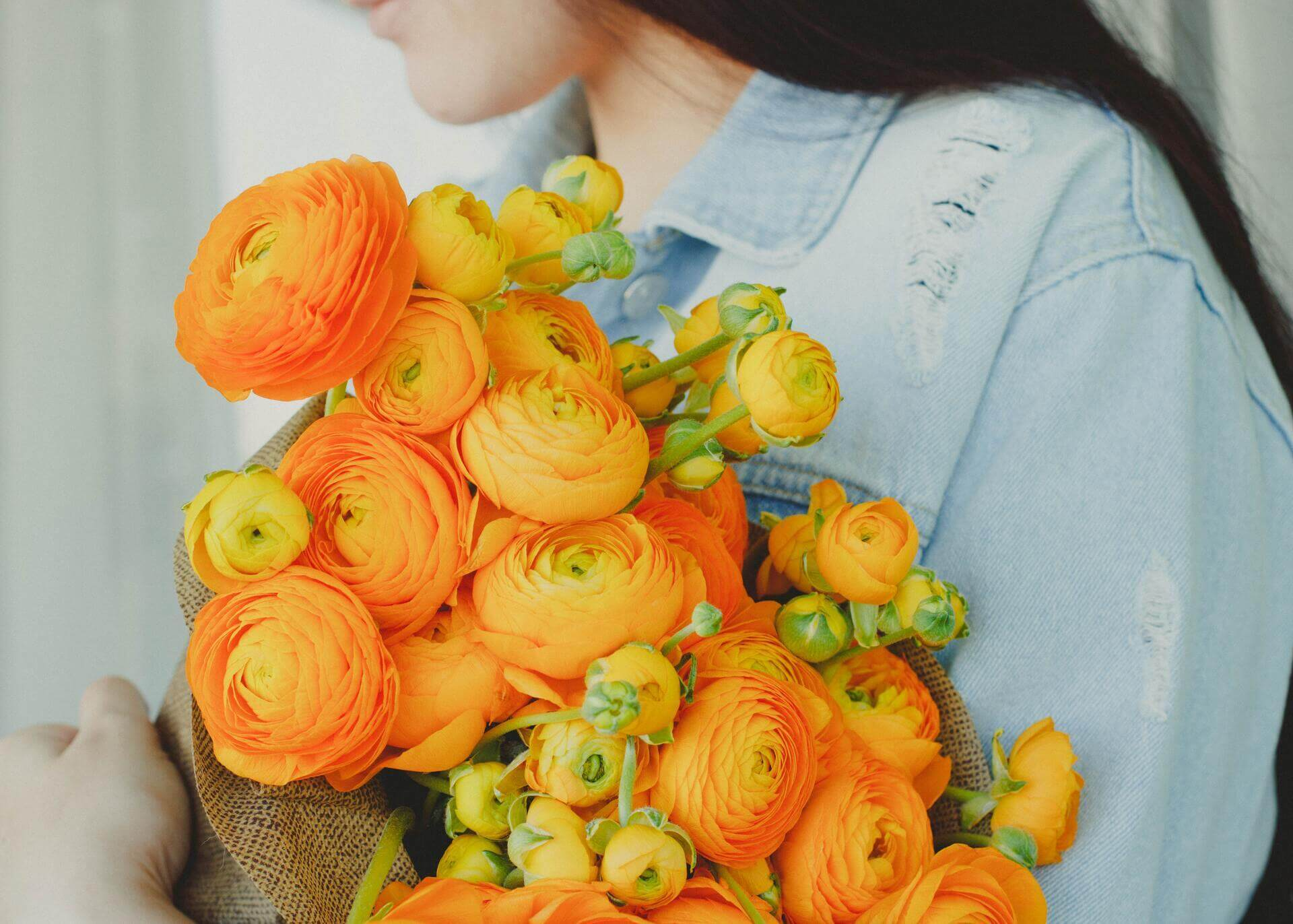 woman holding yellow flower bouquet