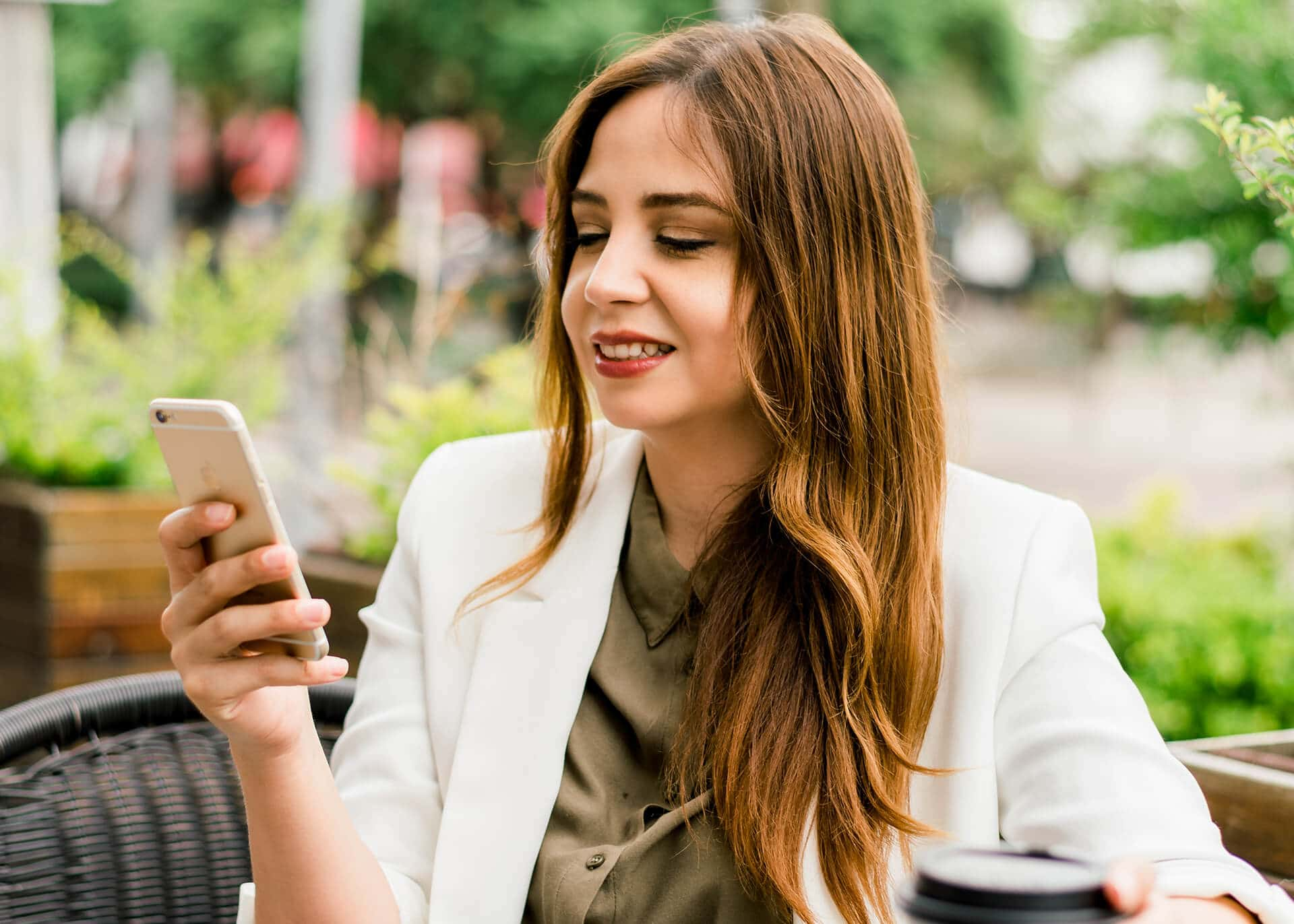 woman reading text message frowning