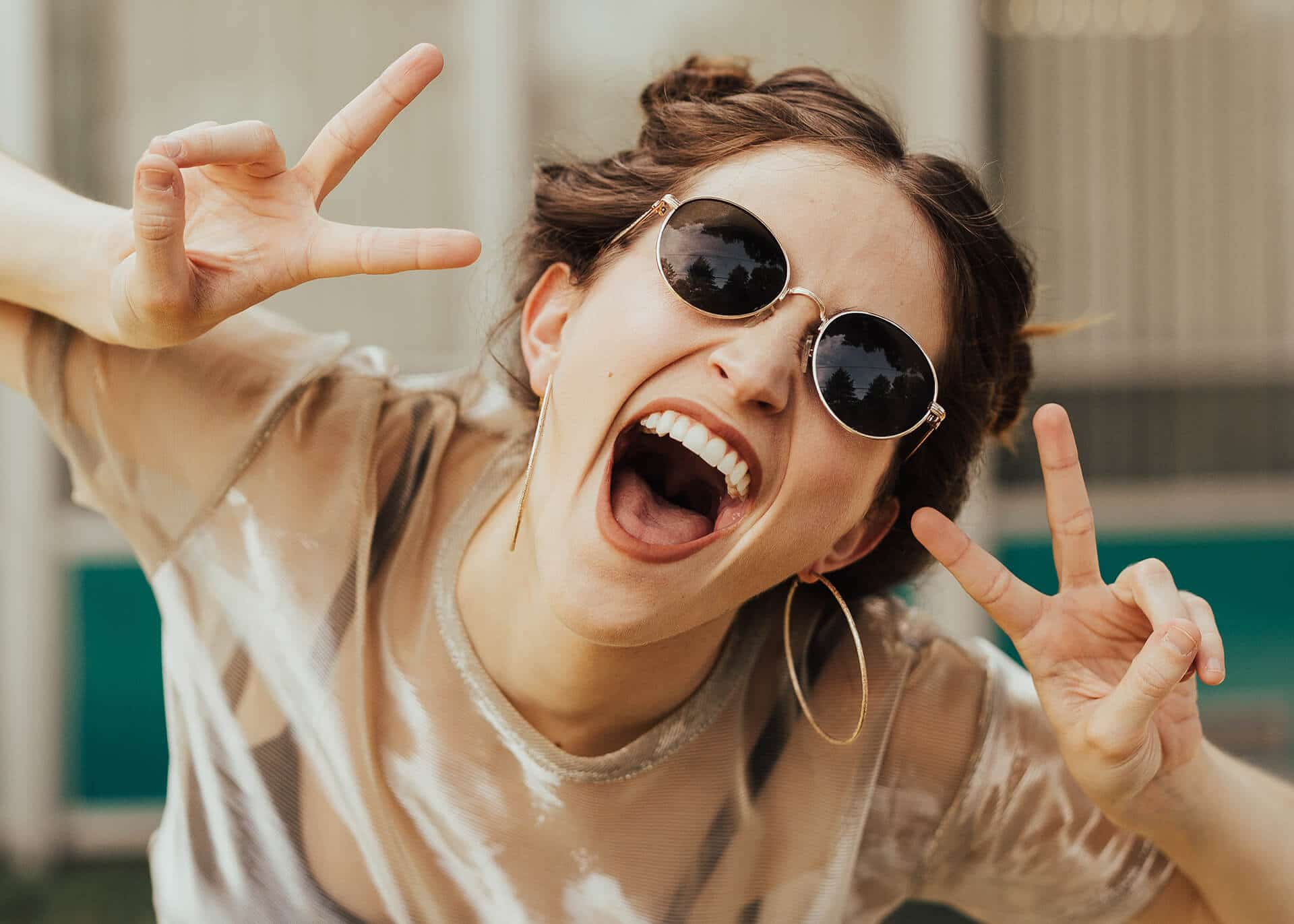 young confident woman with sunglasses
